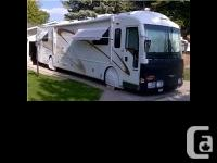 2001 American Coach Eagle M-40MS. The RV sits on a