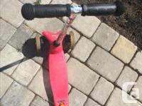 Used orange/pink Micro scooter for sale. Retails new