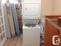 Used stackable Kenmore washer and dryer combo in great