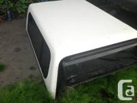 We have a used White Ford Ranger Canopy in stock.  Cash