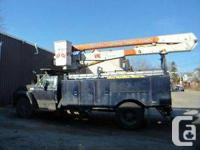 For sale is a large boom/utility truck. It's a 1989