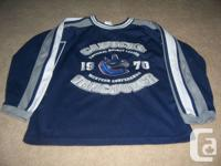 I am selling 3 kids sized Vancouver Canucks jerseys