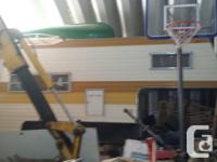 Older camper with easy boat loader and fiberglass