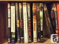 Various DVDs for sale. Some movies, some TV shows, some