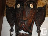 THESE ARE SEVERAL HAND CARVED WOODEN MASKS FROM VARIOUS