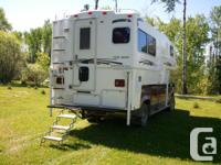 10' Northern Lite camper. Like new condition. Two piece