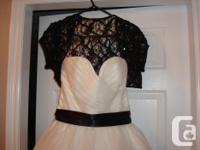 a beautiful diamond white veil and black vest with