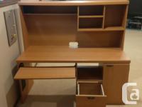 Hi, we have for sale a computer desk with sliding