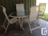 Oval Table is 40.5 in. Wide 73 in. Long 27.75 in. Tall