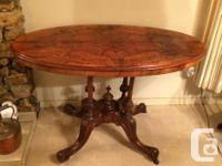 Burl walnut parlour table with quadruped pedestal