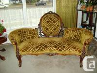 This is a gorgeous cameo-back victorian settee, not a