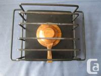 A vintage 70's made in Switzerland fondue set with a