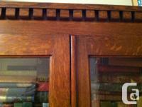 This 5 shelf bookcase has its original glass doors;