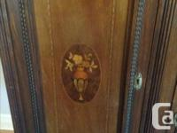 wooden cabinet w/mirror. No damage. Glass is beveled