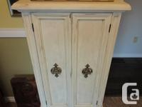 Lovely vintage, all wood cabinet with wine rack. Holds