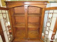 Very nice mid size vintage cabinet. Doors and drawer