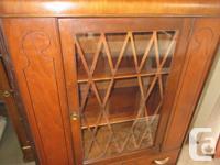 Vintage walnut china cabinet. 2 shelves in upper