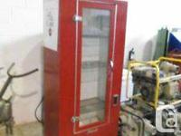 1960's vintage Ideal Brand upright coke fridge -