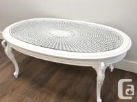 Vintage cane top coffee table, with a glass top.