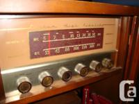 Vintage Console Stereo with dual RA speakers. Radio and