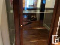 Dark finished wood display case 59 T x 14 D x 46 W,