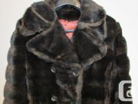Beautiful vintage long dark brown faux fur coat. Unique