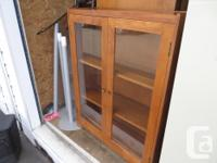 Vintage glass door wooden bookcase - $175 obo Size 36