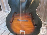 Circa 1962 Harmony Arch-top and back tenor guitar.