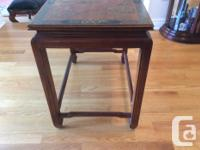 Solid wood, possibly rosewood table with Japanese