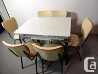 This is classic vintage kitchen table and six chairs.