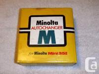 For sale is a vintage Minolta Autochanger for a Minolta
