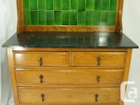 This is a beautiful antique oak washstand or cabinet