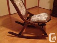 This old but very cute rocking chair is in great