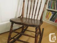 Early 1900s solid oak press back Shaking Chair in