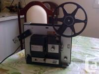 Bell and Howell autoload model #4717 projector  Yashica