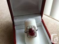 Vintage cocktail ring features a large cushion reduced