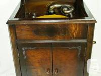 This is lovely antique Show burl walnut cupboard
