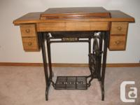 Singer treadle sewing machine in working condition.