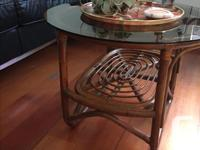 This beautiful smoked glass rattan coffee table is the