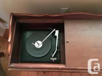 Vintage wooden Silvertone stereo cabinet from 1960s or