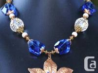 Big, bold elegance this Sapphire Sunflower Necklace is