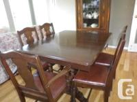 Beautiful Wood Maple Dining Room Table with four chairs