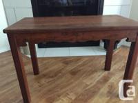 Lovely side table. I believe it is a walnut top. All