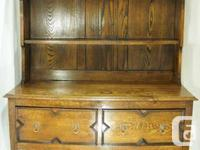 This is a lovely antique Welsh oak sideboard with plate