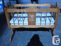 My father made this cradle for my first child. It is