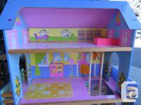 Nice wooden vintage Barbie type dollhouse, it has four