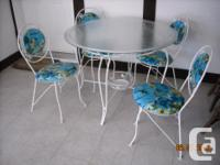 Vintage wrought iron dinette set of table and 4 chairs.