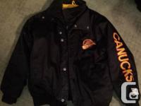 this is a gently used vintage canucks winter jacket