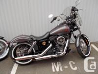 I HAVE FOR SALE A 2014 DYNA STREET BOB WITH A TON OF