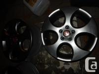"""Volkswagen GTI 18""""stock rims with Metallic gray."""